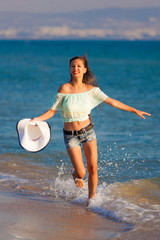 brunette woman run sea in jeans shorts