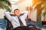 Fototapety Businessman is dreaming about vacations