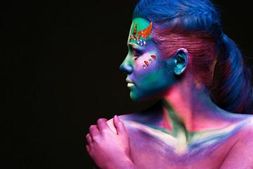 Portrait of beautiful woman with body art
