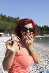 Pretty woman enjoying fresh Mediterranean scampi