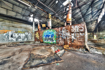 Rusted boiler in an abandoned warehouse