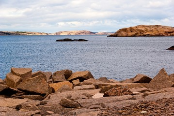 Landscape with ocean and red granite boulders.