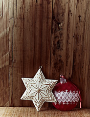 Vintage Christmas decorations on a wooden background