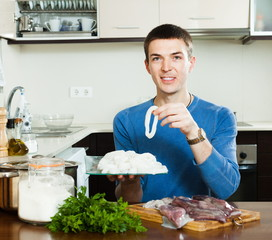 Happy man with raw squid