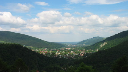 time lapse of Carpathian Mountains and small village between