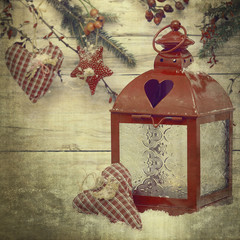 Burning lantern and christmas decoration in old style