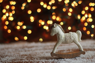 rocking horse on christmas background