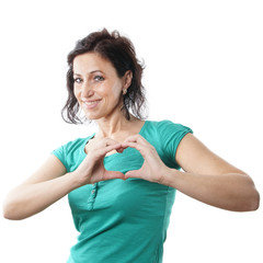 mid age woman forming heart shape