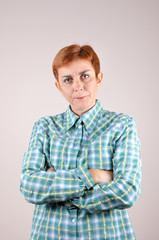Angry and nervous woman with crossed arms