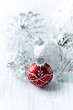 White and red Christmas glass ornaments; close up