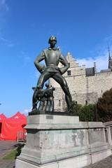 Statue of  Lange Wapper front of Het Steen, Antwerp, Belgium
