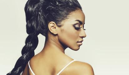 Profile of beautiful young woman braids hair