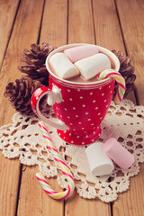 Hot chocolate and marshmallows in red polka dots cup
