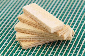 Vanilla wafers on green bamboo mat