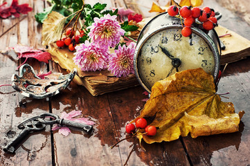 rainy autumn weather,the old clock,fallen leaves