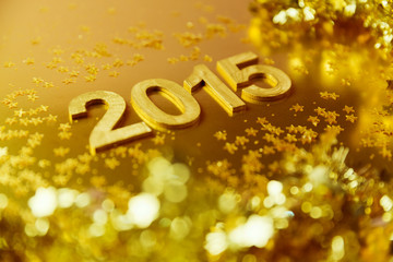 New Year 2015  golden background. Shallow depth of field