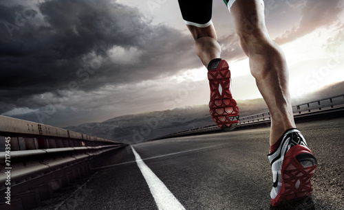Sports background. Runner feet running on road closeup on shoe. - 71743545
