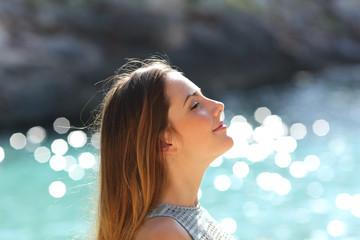 Girl breathing fresh air on a tropical beach on holidays