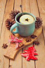 Hot drink with apple and spices for Christmas celebration