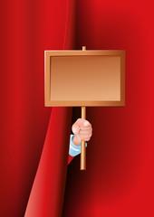 Weihnachtsmann Hand hält Schild hinter Vorhang