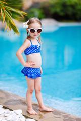 Little girl near swimming pool