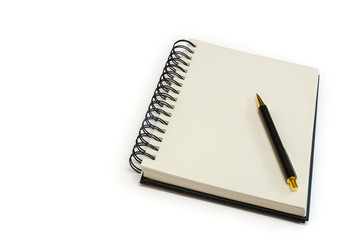 an isolated ringed blank notebook with a pen