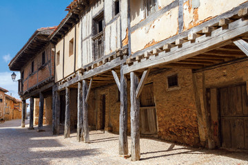 Arcades amd old houses in Calatanazor, Soria, Spain