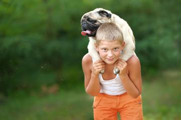 Portrait of a boy with dog pug
