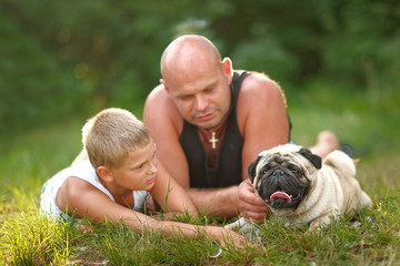 portrait of the pope and his son on nature in summer