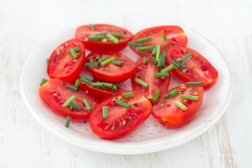 salad tomato with green onion in plate