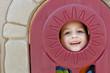 Child in playhouse window