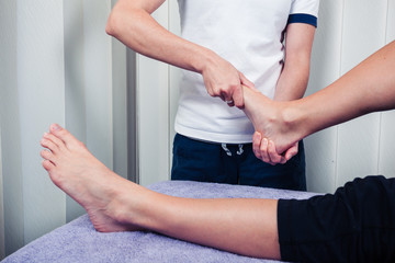 Physiotherapist treating foot
