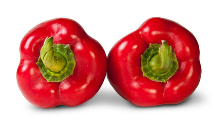 Two Red Bell Peppers Lying Beside