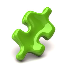 Green jigsaw piece on white background