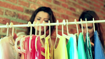 Women looking on colorful clothing in the boutique