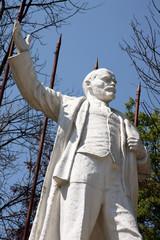 Statue of Vladimir Lenin over spring trees, Russia