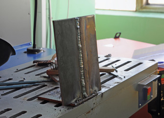 Two plates joined by welding are welding table