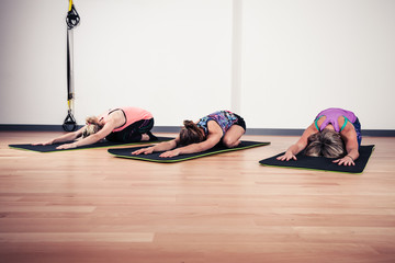 Women doing yoga in gym