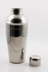 Cocktail shaker in metal against a bright background