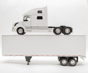 View of transport truck and trailer model on grey background