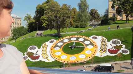 woman does hocus-pocus with floral clock in Kiev