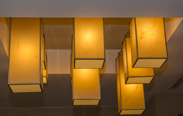 stylish modern, rectangular lights hanging out from ceiling