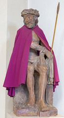 Bruges - The statue of Jesus in the bond and purple coat