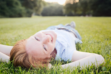 Woman Relaxing in a Park in Summer
