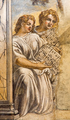 Padua -  The fresco of angels with music in church San Francesco