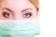 Closeup of woman in green face mask. Safety in risk work.