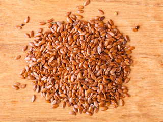 Healthy diet. Heap of flax seeds linseed on wooden background