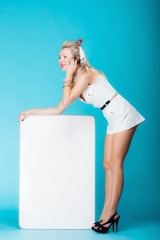 Sexy woman with blank presentation board banner