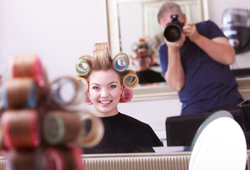 Cheerful happy blond girl hair curlers rollers hairdresser