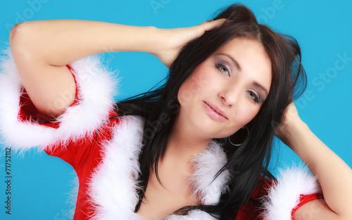 canvas print picture Portrait woman wearing santa clause costume on blue